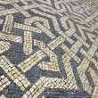 Portugal. Lisbon. Typical portuguese cobblestone pavement - Stock Photo