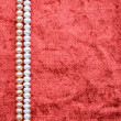 White and pink pearls on the terracotta velvet — Stock Photo