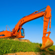 Big orange excavator — Stock Photo