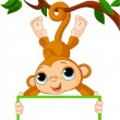 Baby monkey on a tree holding blank sign — Stock Vector
