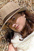 Charming woman in a hat — Stock Photo