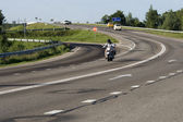 A motorcyclist going on a highway — Stock Photo