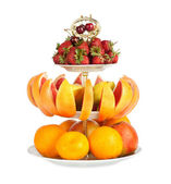 Large amount of fresh fruit on a isolated white background — Stock Photo