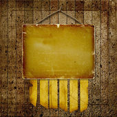 Prázdný kus dřeva viset na hřebíku na abstraktní pozadí — Stock fotografie