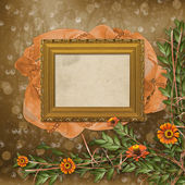 Wooden frame for photos with bunch of flowers — Stock Photo