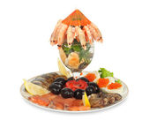 Appetizer of shrimp, fish, caviar, olives and fresh vegetables — Stock Photo