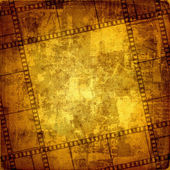 Old frame and grunge filmstrip on the grunge background — Stock Photo