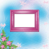 Wooden frame for photo with pink orchids and green fern — Stock Photo