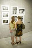 Two woman on photo exhibition — Stock Photo