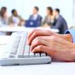 Image of male hands typing on keyboard in a working environment — Stock Photo #5387429