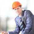 A handsome business construction man on the work site — Stock Photo