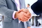 Handshake isolated on business background — Stock Photo