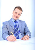 Full length of a handsome business man with hands folded against white back — Stock Photo