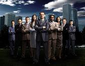 International business team over modern urban background — Stock Photo