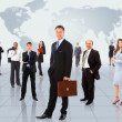 Businessmen standing in front of an earth map — Stock Photo #5497788