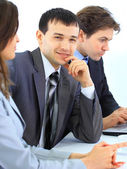 Young businessman in business meeting at office — Stock Photo