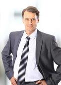 Closeup portrait of a happy mature business man smiling - Copyspace — Stock Photo