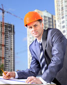Site manager in the office with helmet — Stock Photo