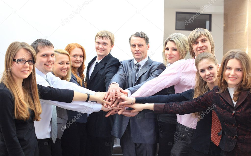 Business team putting their hands on top of each other  — Stock Photo #5523922