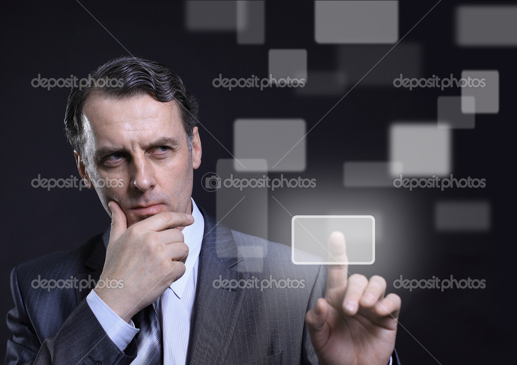 Business man pressing a touchscreen button  — Stock Photo #5524228