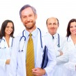 Portrait of group of smiling hospital colleagues standing together — Stock Photo #5563631