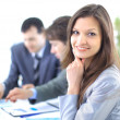 Portrait of successful businesswoman and business team at office meeting — Stock Photo #5571076