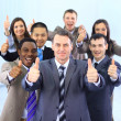 Happy multi-ethnic business team with thumbs up in the office — Stok fotoğraf