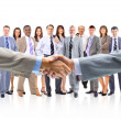 Handshake isolated on business background — Stock Photo #5574390