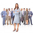 Happy young business woman standing in front of her team — Stock Photo #5574789
