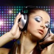 Portrait of a young dancing girl in headphones — Stock Photo