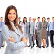 Stock Photo: Business womleading her team isolated over white background