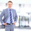 Portrait of a happy young businessman, smiling, indoor — Stock Photo