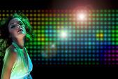 Beautiful young woman dancing in the nightclub — Stock Photo