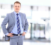Portrait of a happy young businessman, smiling, indoor — Стоковое фото