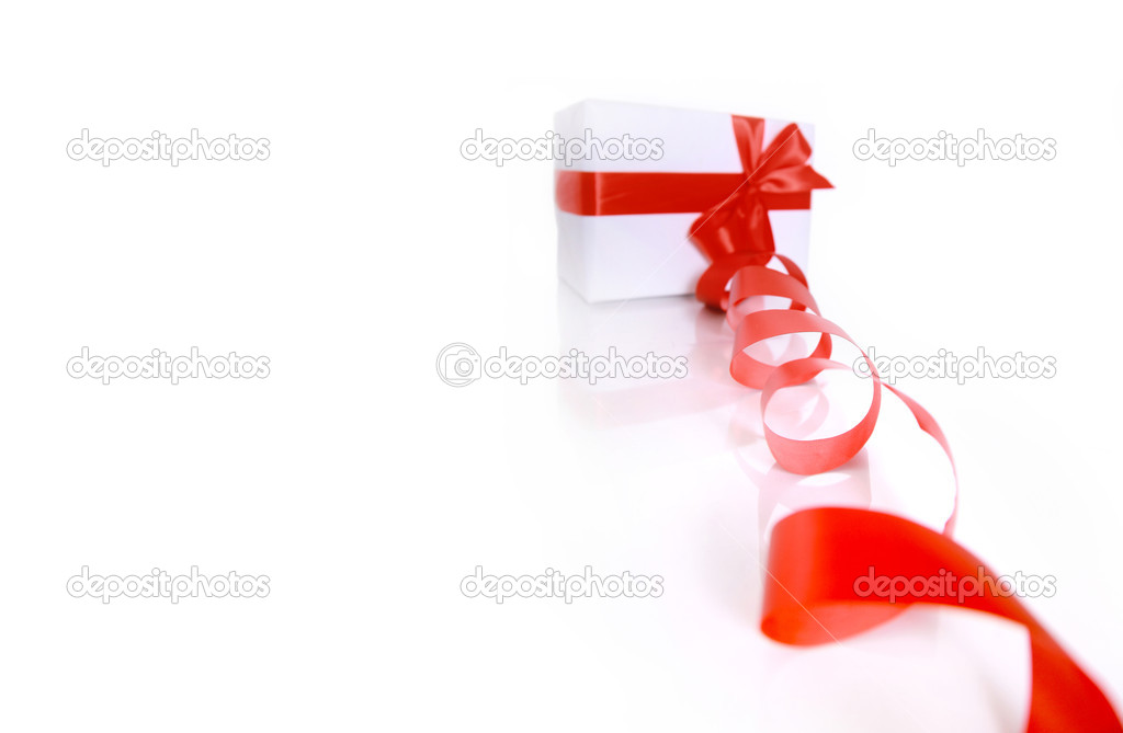 gift wrapped with a red ribbon on a white background — Stock Photo #5570724