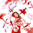Excited attractive woman with many gift boxes and bags. - Stock Photo
