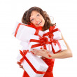 Young woman with gifts. Shot in studio. — Stock Photo #5632537