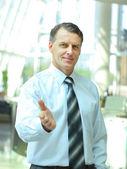 Businessman extending hand to shake — Stock Photo