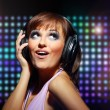 Portrait of a young dancing girl in headphones — Stock Photo #5658189