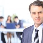Senior businessman in office — Stock Photo