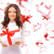 Picture of cheerful santa helper girl with gift box — Stock Photo #5658290