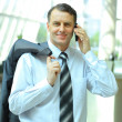 Mature executive man giving explanations and talking at phone mobile - Stok fotoğraf