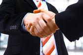 Handshake isolated on light background — Stock Photo