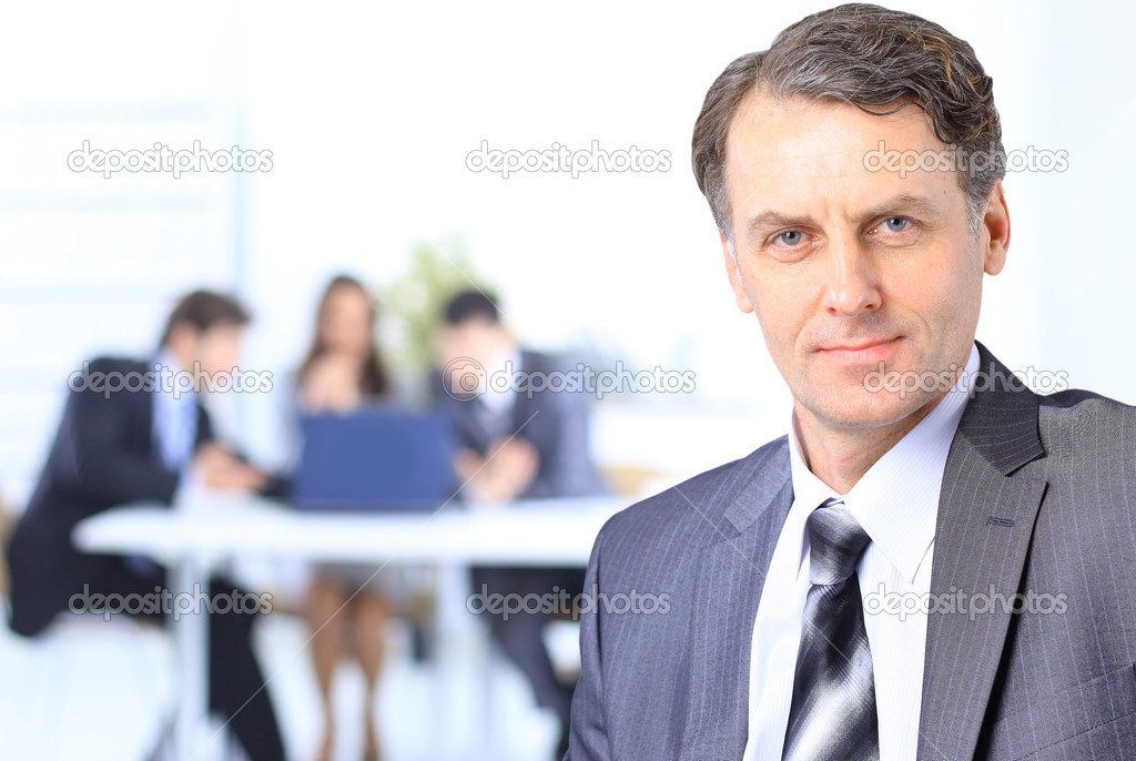 Senior businessman in office — Stock Photo #5658275