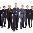 Business team formed of young businessmen and businesswomen standing over a — Stock Photo #5663773
