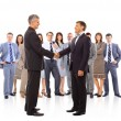 Handshake isolated on business background — Stock Photo #5705777