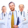 Foto de Stock  : Portrait of group of smiling hospital colleagues standing together