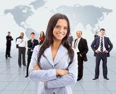 Mulher de negócios e sua equipe — Foto Stock