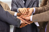 Group of business making a pile of hands in a light and modern offic — Stock Photo