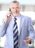 Okouzlující podnikatel telefonování ve své kanceláři — Stock fotografie